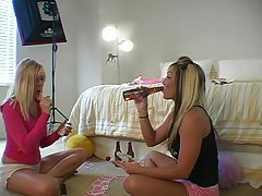 Girls drink beer and play cards tubes