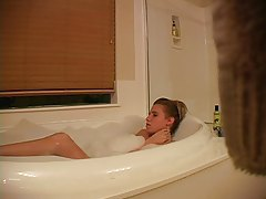 Hidden camera captures girl masturbating in bathtub tubes