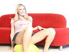 Sweetie in skirt pops a balloon tubes