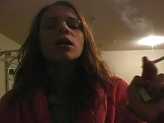 Teenager in bathrobe smokes sensually tubes