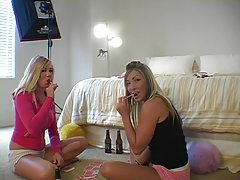 Girls play cards and suck lollipops on camera tubes