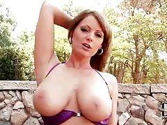 Shiny purple bikini on a big breasted brunette tubes