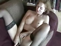 Horny brunette milf in sexy stockings sliding dildo in her pussy tubes