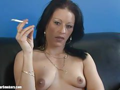 Sultry brunette milf with small tits enjoying a good smoke tubes