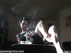Noir style smoking with sexy girl in a dress tubes