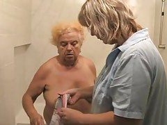 Nurse washes down old blonde granny tubes