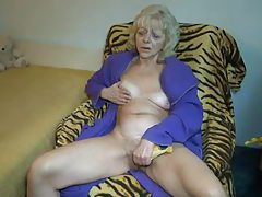 Masturbating granny fondles her titties tubes