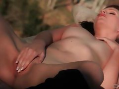 Pretty girl quietly masturbates outdoors tubes