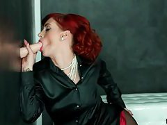 Redhead in sexy satin blouse blows a dildo tubes