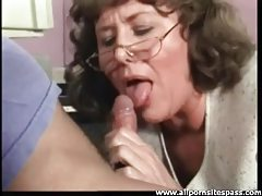 Old secretary sucks dick in the office tubes