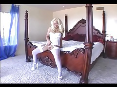 Busty milf rubs her pussy in a teddy and stockings tubes