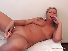 Close up on pretty mature pussy toying solo tubes