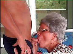 Granny in leopard print sucks his dick tubes