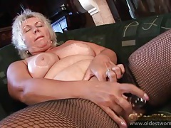 Solo granny in fishnets plays with her pussy tubes
