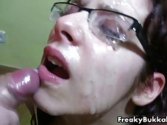 Filthy brunette whore gets her glasses covered with cum in this bukkake fest tubes