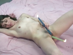 Slut stuffs lit candles in her cunt tubes