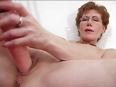 Mature masturbates freshly shaved vagina tubes
