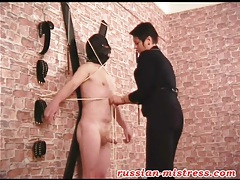 Mistress hoods and ties up her slave tubes
