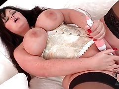 Chubby girl in tight corset masturbates pussy tubes