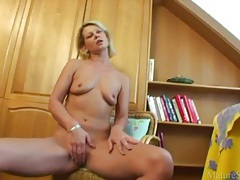 Cute naked milf gives pussy joy with toy tubes