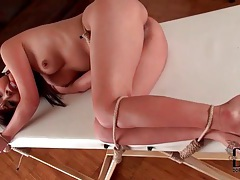 Bound and gagged girl pisses on a table tubes