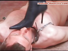 Bitch in high heeled leather boots tramples him tubes