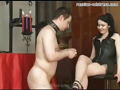 Abusive goddess in leather makes him hurt tubes