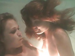 Kissing and caressing girls underwater tubes