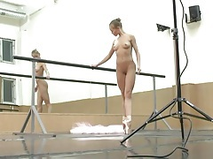 Ballerina onn her toes with no clothes on tubes