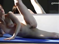 Nude ballet dancer is flexible in the mirror tubes