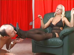 Mistress in stockings pisses on his face tubes