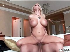 Pornstar Holly Halston sits on big cock tubes