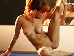 Redhead with tiny tramp stamp models hot body tubes