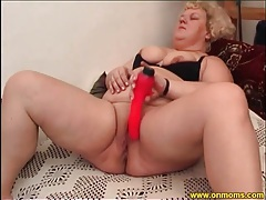 Huge ass mature masturbates with pink toy tubes