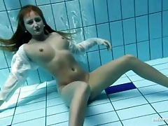 Cute girl with curves swims sensually tubes