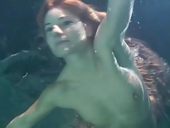 Redhead swimming in a dress is cute tubes