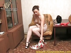 Sexy brunette puts on a pair of white pantyhose tubes