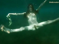 Redhead skinny dipping in the ocean tubes