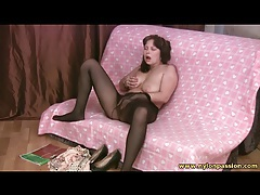 Voluptuous lady masturbates in pantyhose tubes