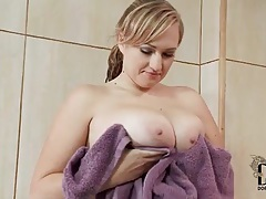 Cute girl washes her big tits in the bathtub tubes