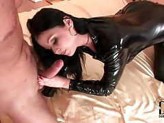 Cocksucker in shiny black latex catsuit tubes