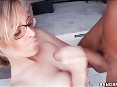 Blue eyed girl in glasses sucks big cock tubes