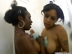 Black chicks take a shower and hook up tubes