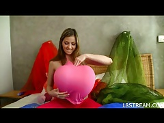 Solo babe plays with balloons and a dildo tubes