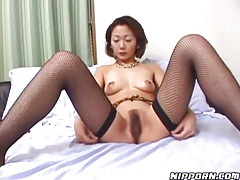Hairy pussy between her legs in fishnets tubes