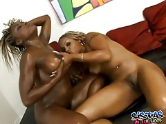 Two ebony girls grease up and fondle each other tubes