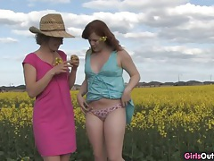 Natural lesbian girls on a canola field tubes