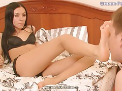Mistress in lingerie gets her toes sucked tubes