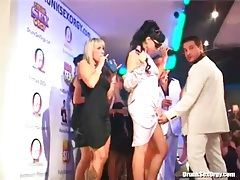 Watch champagne drinking ladies on the stage tubes