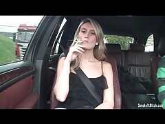 Sexy blonde smokes cigarette in the car tubes